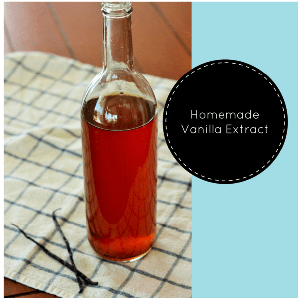a bottle of Homemade vanilla extract on a white checkered cloth