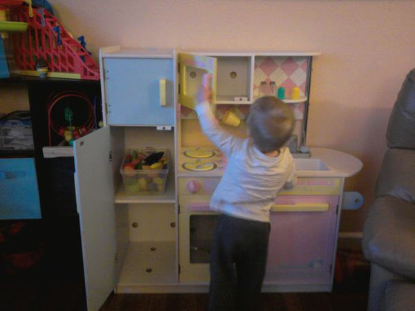 Free toys + imagination = 1 happy boy