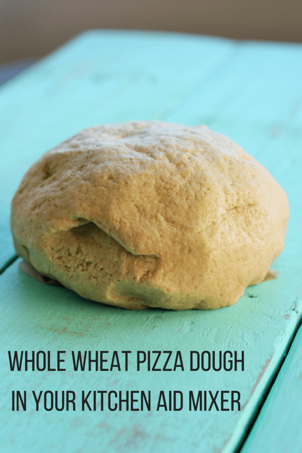 Whole wheat pizza dough in your Kitchen Aid mixer is simple, fast, and delicious. The perfect recipe for anyone looking for easy whole wheat recipes.