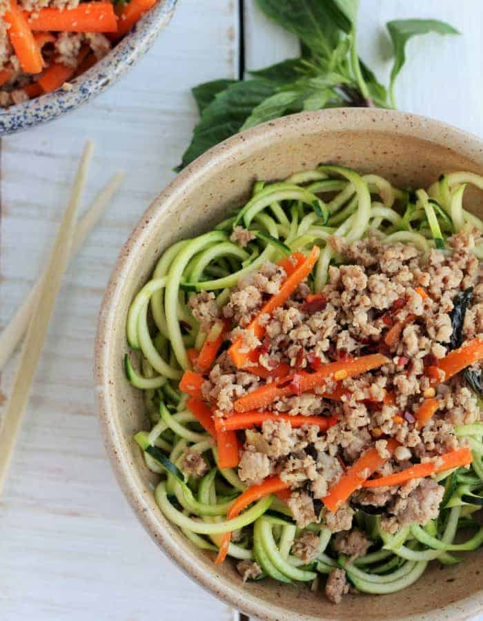Basil Thai Chicken With Zoodles in a bowl with chopsticks