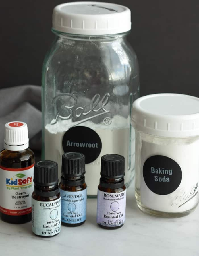 Jars of arrowroot and baking soda and bottles of essential oils