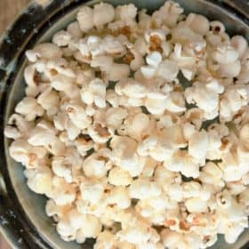 stove top popcorn in a blue bowl