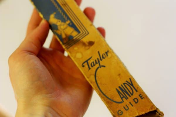 a antique candy thermometer in a box
