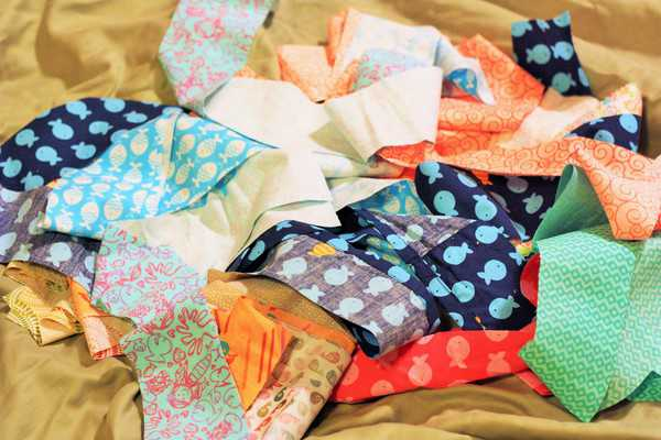 a pile of scraps for beginner quilts