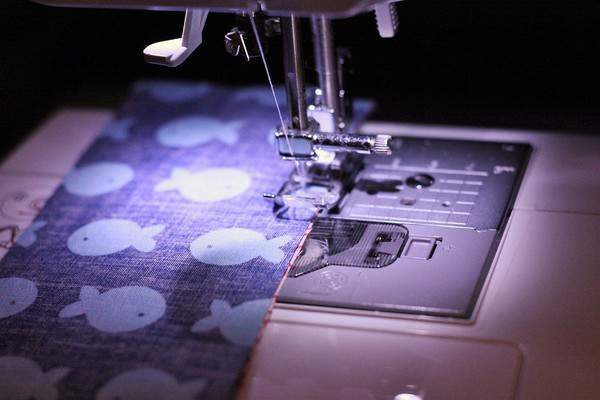 Two pieces of fabric for beginner quilts in a sewing machine