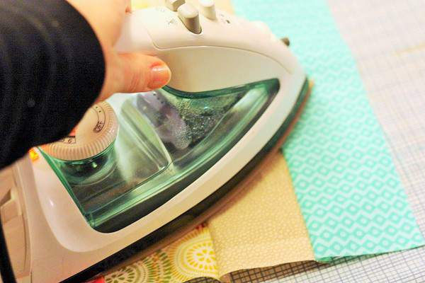 a iron pressing strips of fabric for beginner quilts