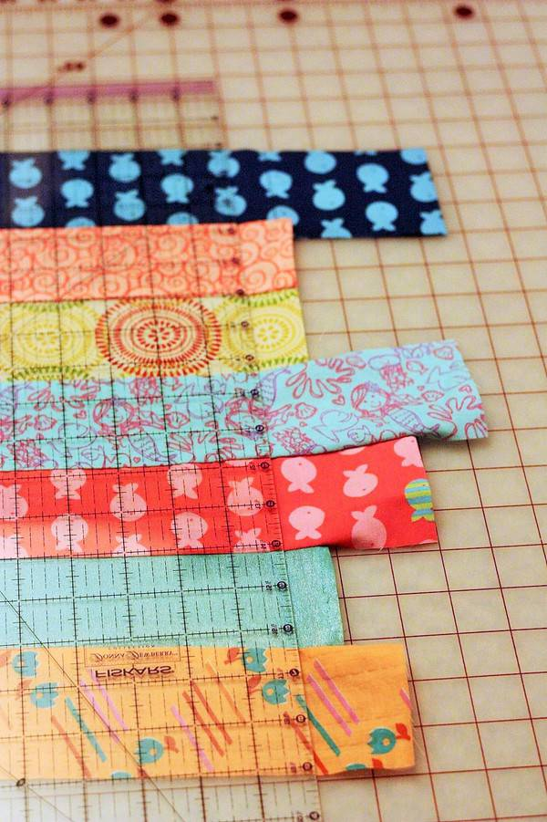 strips of fabric for beginning quilts being cut