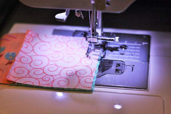 strips of fabric for beginner quilts in a sewing machine