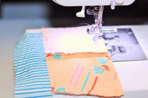 "a ""wrong side"" strip of fabric for beginner quilts in a sewing machine"