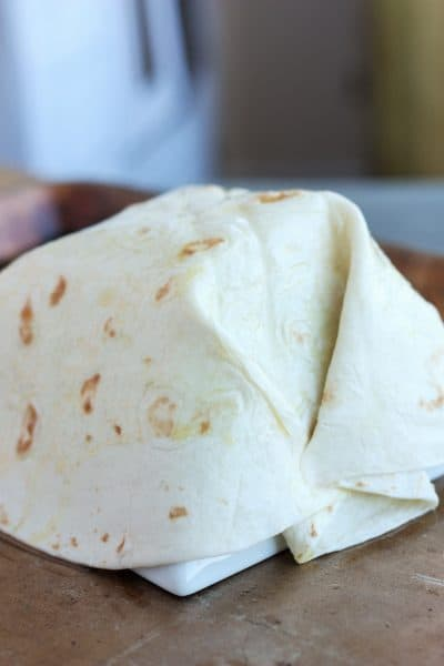 tortilla placed over a bowl | sustainablecooks.com