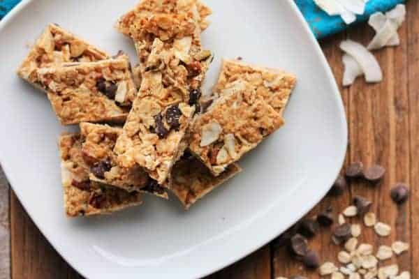 homemade granola bars on a plate with a chocolate chips | www.sustainablecooks.com