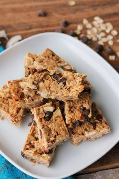 homemade granola bars on a plate with chocolate chips and oats | sustainablecooks.com