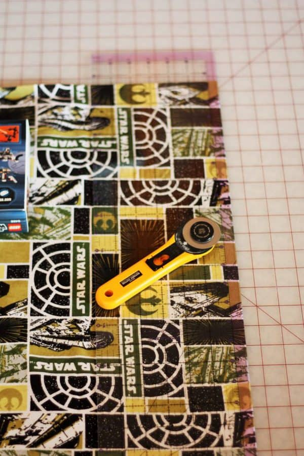 fabric with a rotary cutter for making reusable cloth gift bags