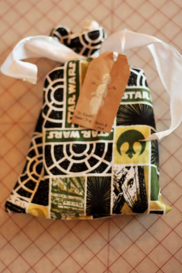 a reusable cloth gift bag with a bow