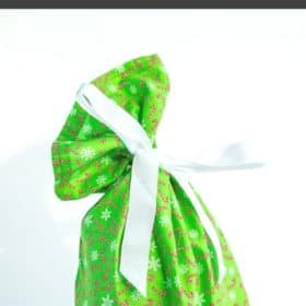 a green cloth giftbag