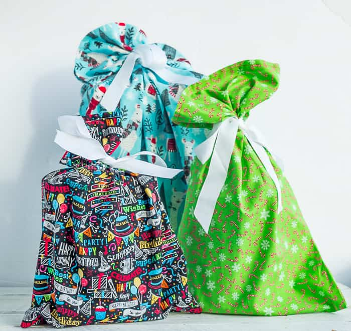 3 colorful fabric giftbags with white bows