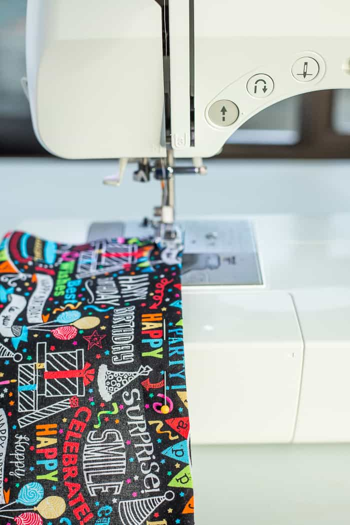 fabric on a sewing machine showing how to sew a seam