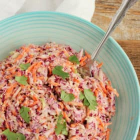 A blue bowl full of homemade easy coleslaw