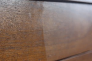 wooden tv stand that has been dusted