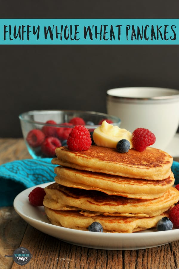 An easy from-scratch recipe for the Fluffiest Whole Wheat Pancakes you've ever had. These healthy make-ahead pancakes are made with 100% whole wheat flour and buttermilk. #sustainablecooks #pancakes #wholewheatpancakes #fluffypancakes #makeaheadbreakfast
