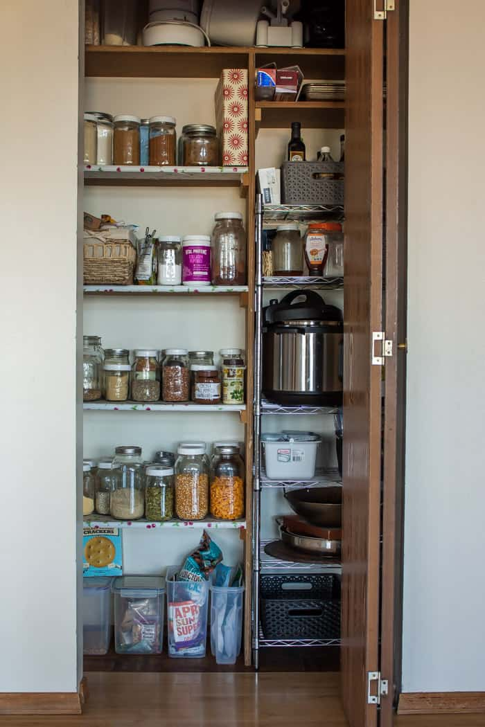 a pantry stocked with mason jars and other essential ingredients
