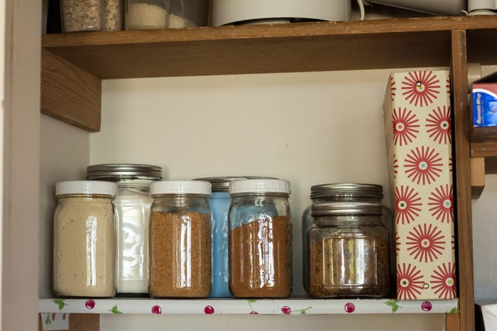 baking essentials on a pantry shelf