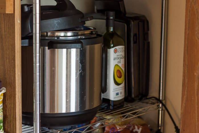 an instant pot on a pantry shelf