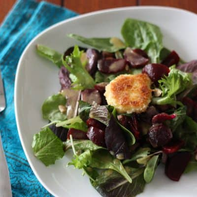 Mixed Greens With Pan-Fried Goat Cheese, Roasted Beets, and Hazelnuts