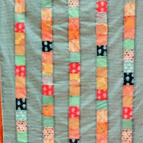 a beautiful quilt made during a tutorial on simple beginner quilts