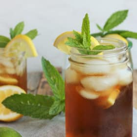 Two glasses of healthy sweet tea with mint and lemons