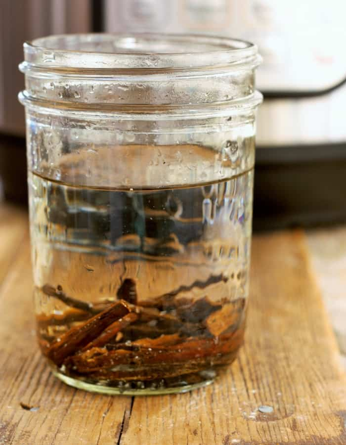 vanilla beans and vodka in a jar for homemade vanilla extract