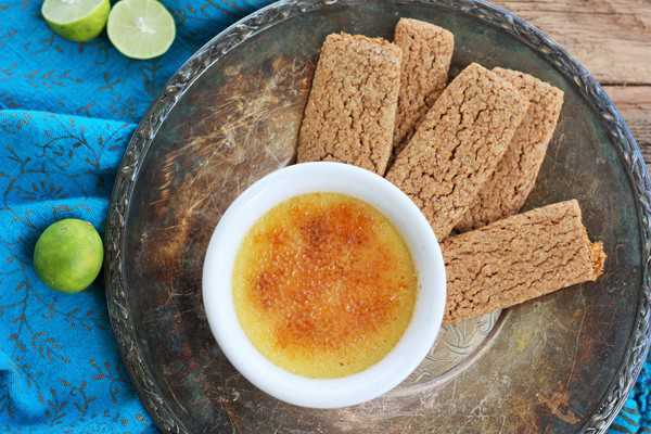 Key lime creme brulee with graham crackers on a plate