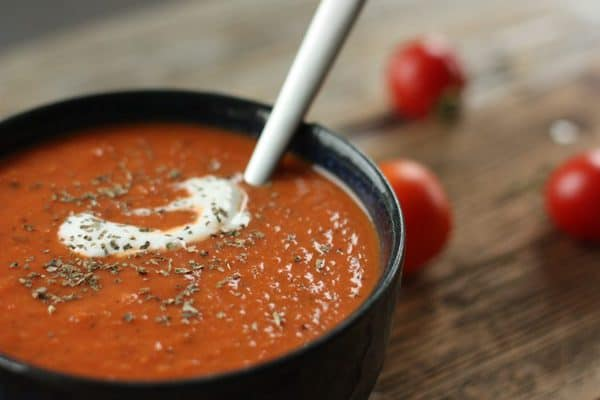 tomato soup in a bowl with creme fraiche | sustainablecooks.com