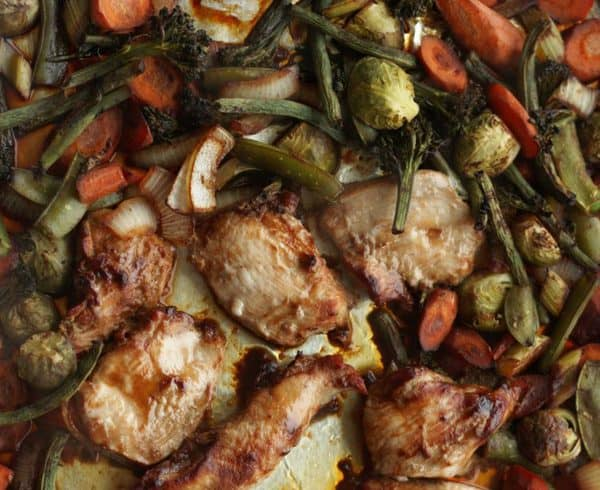roasted chicken and veggies on a sheet pan