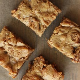 Four homemade nordy bars on a piece of parchment