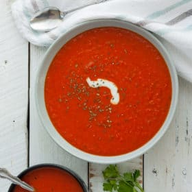 Two bowls of Whole30 tomato soup with parsley