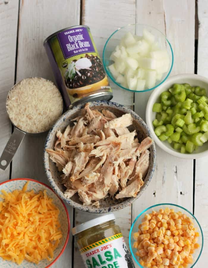 bowls of turkey, rice, onion, cheese and other ingredients for leftover turkey casserole