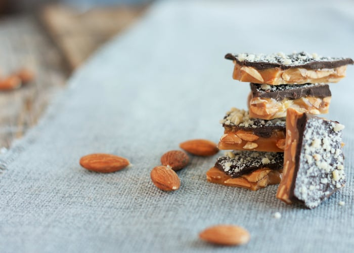 homemade almond roca on a gray cloth