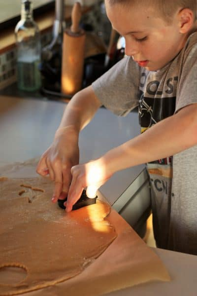 a child making whole wheat sugar cookies