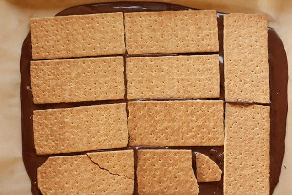 graham crackers over melted chocolate