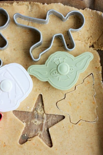 whole wheat sugar cookie dough rolled out with cookie cutters