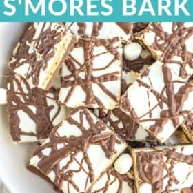 a plate of chocolate smores bark with mini marshmallows