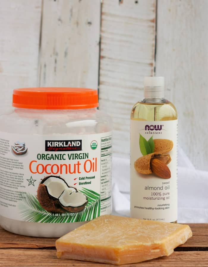 ingredients for a lotion bar recipe - coconut oil, sweet almond oil, and a bar of beeswax