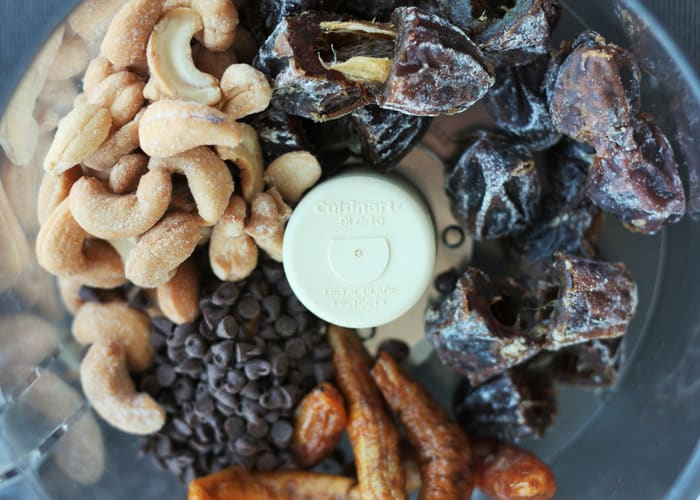 Dates, cashews, and dried bananas in a food processor