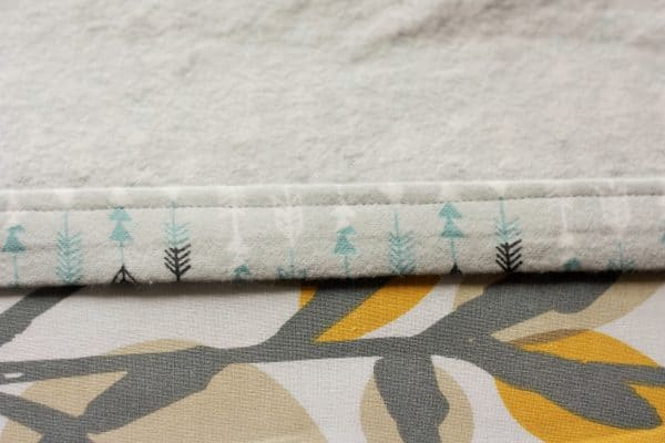 folded and sewn fabric on a floral ironing board
