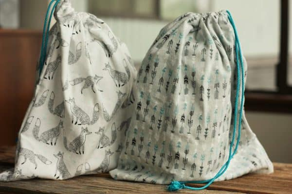 two zero waste shopping bags with blue drawstrings