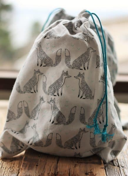 a cloth bag with foxes on it and a blue string
