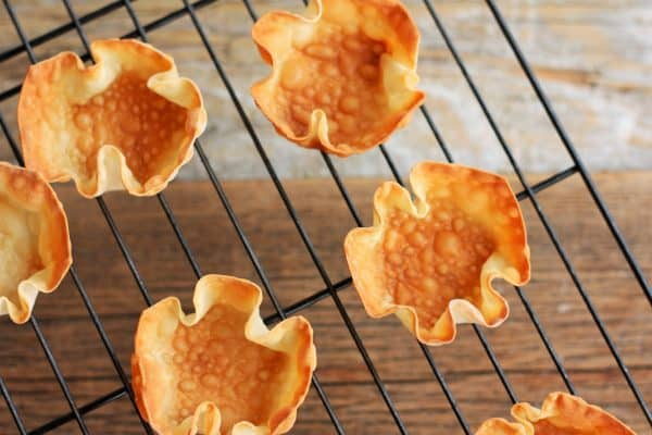 baked wontons on a cooling rack   sustainablecooks.com