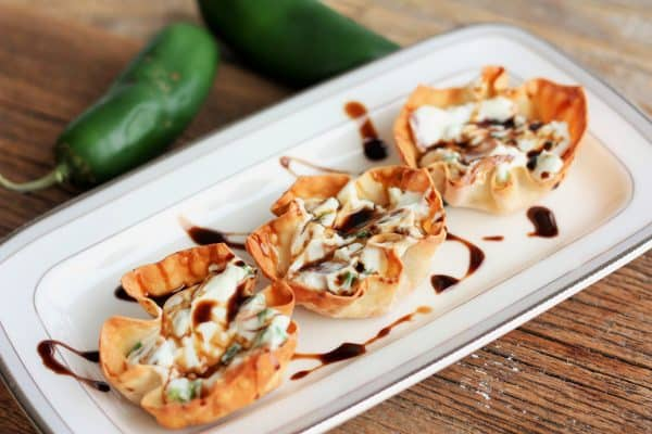 Jalapenos in wontons on a small plate | sustainablecooks.com