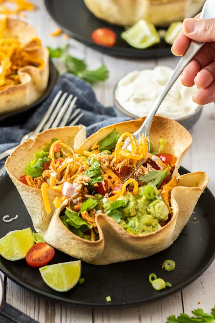 a fork in a baked tortilla bowl
